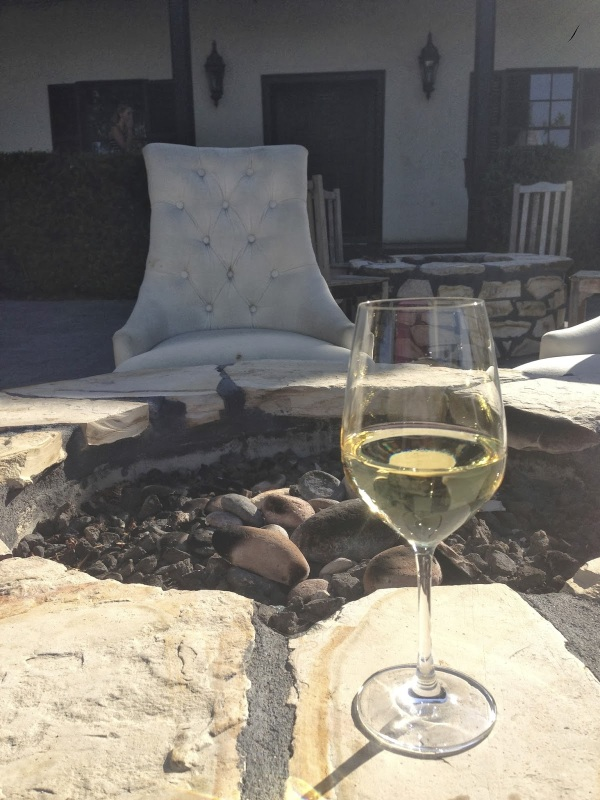 Wine, especially when combined with a good friend and good conversation.