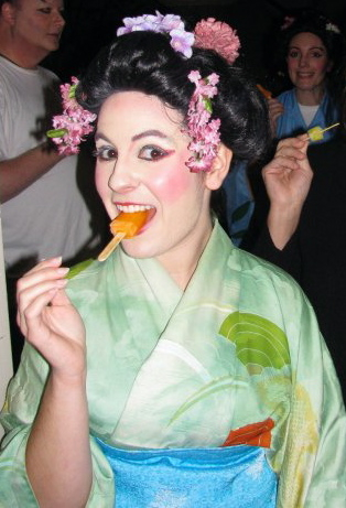 As Peep-Bo in The Mikado, enjoying a popsicle at intermission.