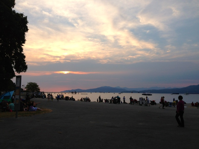 Watching the sun set over Kitsilano Beach.