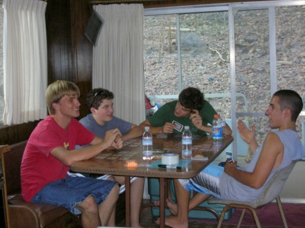 T, our friends, and my brother playing a heated game of Family Business.