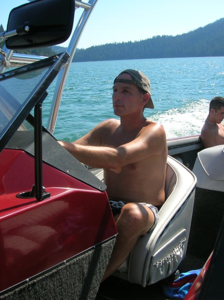 My dad in his element, driving his boat.