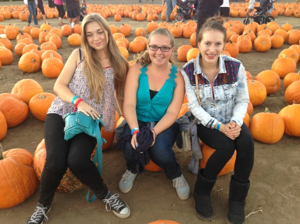 A few of our students enjoying the pumpkin patch.