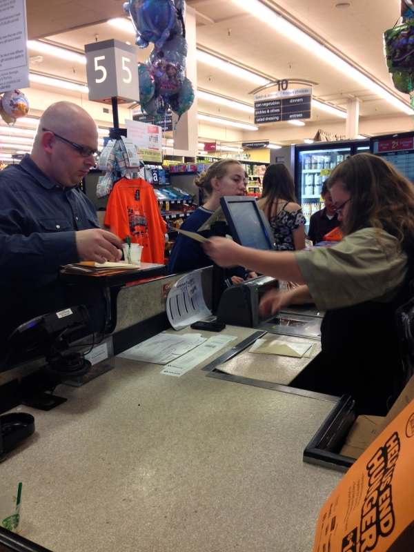 The director and cashier deep in action.